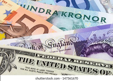 A close-up photograph of  Swedish, United States and Euro currency.