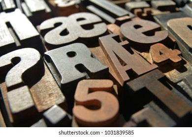 a closeup photograph of a variety of different typefaces in wooden letterpress