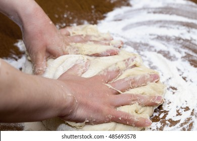 close-up photographed dough for baking a cake at home, the woman's hand can be seen