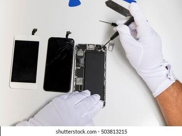 Close-up photos showing process of mobile phone repair.mobile phone repairing, flat lay, top view