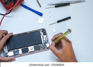 Close-up photos showing process of mobile iphone 6 repair
