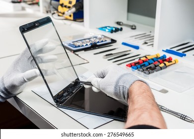 Close-up photos showing process of tablet device repair.