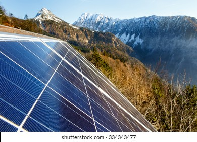 Closeup of photovoltaic solar panels in mountainous area, gathering sunlight. Sustainable resources, environmental conservation, alternative power source and generation, green energy concept.