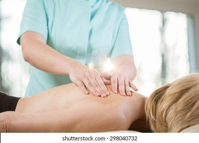 Close-up of physiotherapist stroking the skin during patient's massage