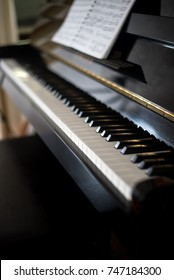 closeup piano keyboard  with songbook