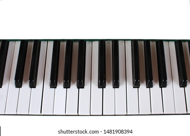 Close-up of piano keys in white and black