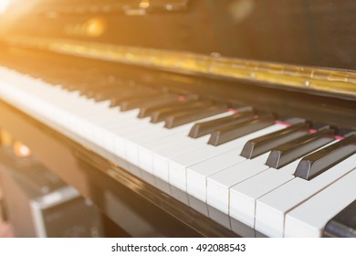 Closeup Piano with a light shining