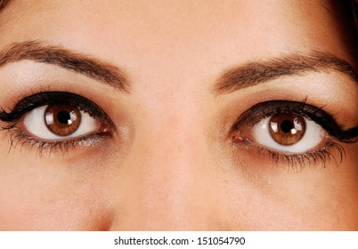 A closeup picture of the beautiful eyes of a young woman.