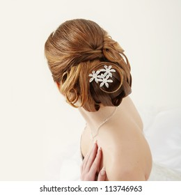 Closeup picture of a bridal hairstyle on white background