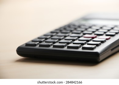 Closeup picture of calculator on the table.