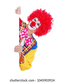 Closeup picture of a clown holding blank board isolated on white background