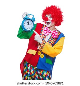 Closeup picture of a clown holding blue alarm clock  isolated on white background