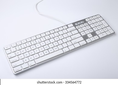 Closeup picture of computer keyboard with white background.