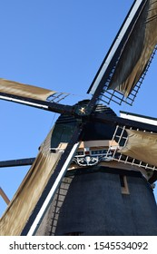 Closeup picture of dutch wind mill painted by Piet Mondriaan near Amsterdam