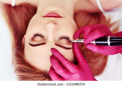 Closeup picture of eyes arrows permanent makeup