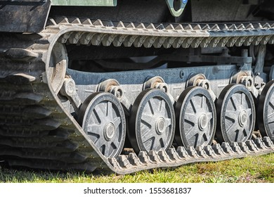 Closeup picture of green caterpillar track of the tank.