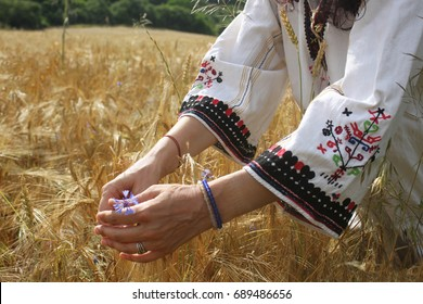 Closeup picture of hands of a woman dressed in Bulgarian folklore costume