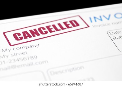 "Close-up picture of an invoice with a red ""cancelled"" stamp on it"
