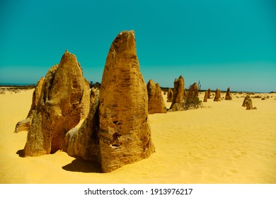 Close-up picture of a limestone rock at the Pinnacles desert with ocean at the background, no people, Pinnacles desert, Namburg national park, Western Australia WA, West coast near Perth