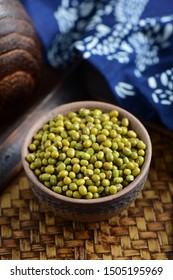 Closeup picture of mung beans in a bowl on vintage chinese style background