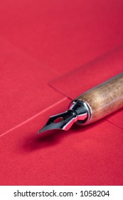 Close-up picture of a pen sitting on an envelope