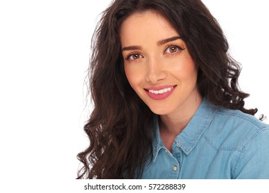 closeup picture of a smiling casual woman with curly hair on white background