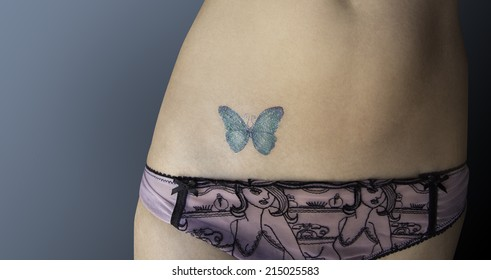 Close-up picture of a tattooed woman in lingerie