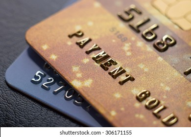 Close-up picture two credit cards with numbers. Macro. Small Depth of field