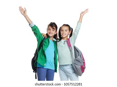 Closeup picture of two girls expressing joy raising hands
