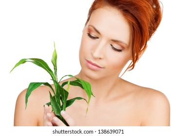 closeup picture of woman with green sprout