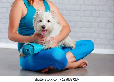 Closeup picture of a yoga girl hugging her doggie