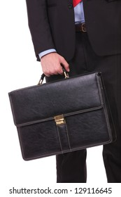 closeup picture of a young business man holding a briefcase on a white background