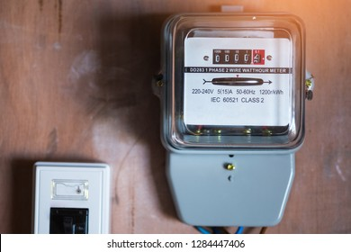 Close-up pictures of electric meter boxes on wood panels.Watthour meter of electricity in home Electronics for use in home.