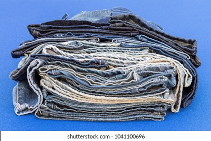 Close-up of pieces of seams, old jeans left over from sewing, repair on blue cloth.
