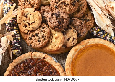 Closeup of pies and cookies for a Thanksgiving Day feast desserts.