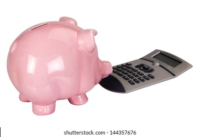 Close-up of a piggy bank with a calculator
