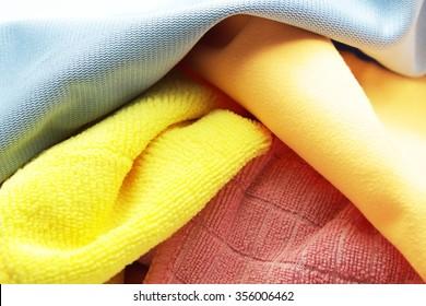 Closeup pile of colorful microfiber towel/cloth for car wipe.