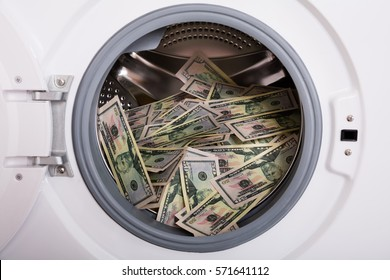 Close-up Of Pile Of Dirty Money Placed In Washing Machine