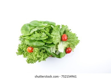 Closeup of a pile of lettuce mix for salad on a white background