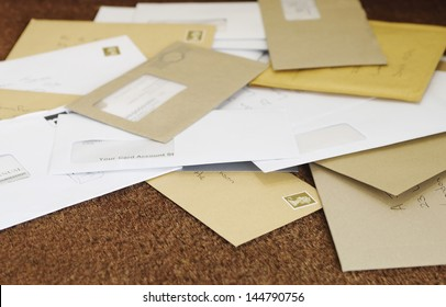 Closeup of a pile of mail on doormat
