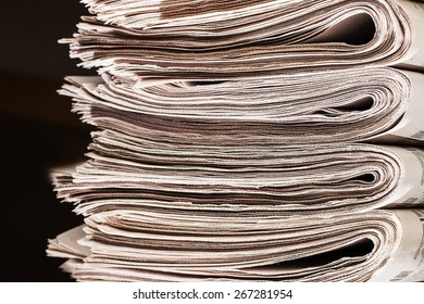 Closeup of a pile of newspapers.  A pile of newspapers