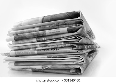 Closeup of pile of newspapers