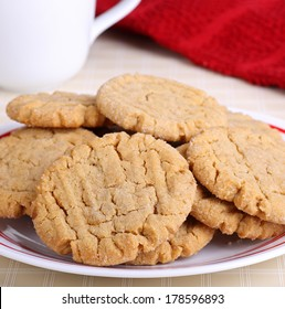 Closeup of a pile of peanut butter cookies on a plate