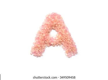 Closeup pile of pink crystal stone in A english alphabet isolated on white background
