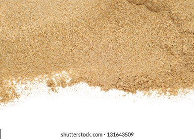 closeup of a pile of sand of a beach or a desert on a white background