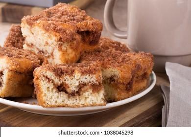 Closeup of a pile of sliced cinnamon swirl coffee cake on a plate