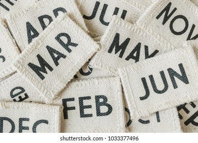 Closeup pile of small fabric calendar in many month textured background
