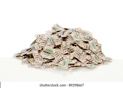 Closeup of a pile of USA hundred dollar bills on white with reflection.