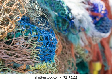 Closeup of a pile of vibrant fishing nets