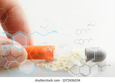 Closeup of pills capsules open and drug powder in capsule heap spread on table white background and hud bio symbo. hand holding part of cap pills .medicines are good treatment if order from the doctor